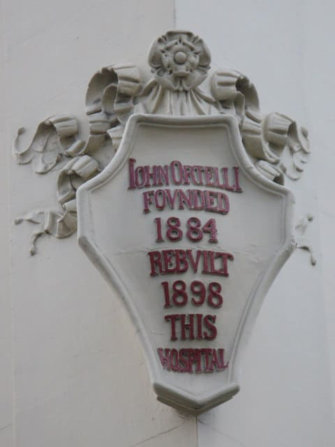 Photo of plaque on Italian Hospital by Mike Quinn